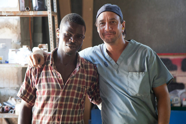 Marty Wagner (right) with a Haitian worker in the generator room at the Crudem foundation in Milot, Haiti.A team of Holy Name Medical Center employees traveled to  Milot, Haiti to run new electric and communications cable, and get a pair of generators installed and operational. The team employed and taught a crew of local Haitian workers on the projects.<br /> Photos from Hopital Sacré Coeur, the CRUDEM foundation, and Holy Name Medical Center's involvement in Milot, Haiti.  Photo by Jeff Rhode / Holy Name Medical Center 9/4/12