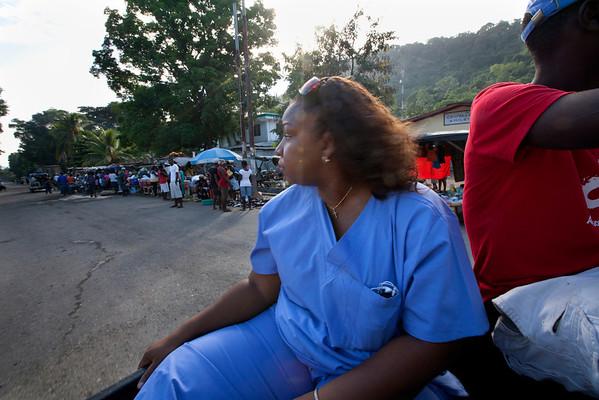 Judith Raymond on the street in Milot, Haiti. <br /> Photos from Hopital Sacré Coeur, the CRUDEM foundation, and Holy Name Medical Center's involvement in Milot, Haiti.  Photo by Jeff Rhode / Holy Name Medical Center 10/24/13