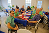 (LtoR) Dr. Chris Englert, Dr. Adam Jarrett, Dr. Judith Kutzleb, Dr. Tim Finley, Judith Raymond, Dr. Mike Conn, Dr. Steve Wells, and Dr. Dave Butler at the newly constructed cafeteria on the campus of Hopital Sacre Coeur in Milot, Haiti. <br /> Photos from Hopital Sacré Coeur, the CRUDEM foundation, and Holy Name Medical Center's involvement in Milot, Haiti.  Photo by Jeff Rhode / Holy Name Medical Center 10/23/13