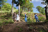 Sr. Anne Crawley, Dr. Judith Kutzleb, and Judith Raymond get help from a local boy climbing a mountain to see a patient that left Hopital Sacre Coeur and needed medical attention. <br /> Photos from Hopital Sacré Coeur, the CRUDEM foundation, and Holy Name Medical Center's involvement in Milot, Haiti.  Photo by Jeff Rhode / Holy Name Medical Center 10/24/13