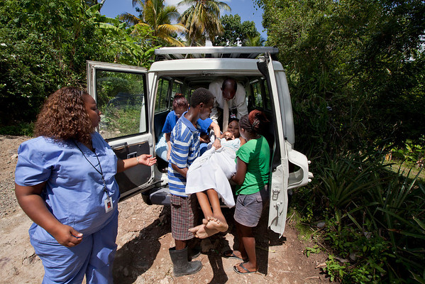 Neighbors hall move Kyleen from Hopital Sacre Coeur back to her home in the mountains of Milot, Haiti. Kyleen is paralyzed and has no family-she is cared for by her neighbors. The transport was a 30 minute Land Cruiser drive over rough terrain in the mountains. <br /> Photos from Hopital Sacré Coeur, the CRUDEM foundation, and Holy Name Medical Center's involvement in Milot, Haiti.  Photo by Jeff Rhode / Holy Name Medical Center 10/24/13