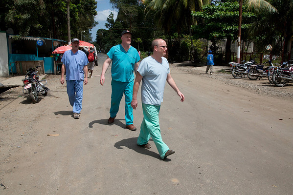 Tom Wall, Pete DeGraff, and Dr. Adam Jarrett of Holy Name Medical Center on the street outside of Hopital Sacré Coeurin Milot, Haiti.  <br />  Photos from Hopital Sacré Coeur, the CRUDEM foundation, and Holy Name Medical Center's involvement in Milot, Haiti.  Photo by Jeff Rhode / Holy Name Medical Center 3/17/13