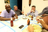 Richard Thomas, John Grangeia, Stewart Simonson, and Ted Carnevale, all from Holy Name Medical Center in Teaneck, NJ, sit down for a meal at the Crudem foundation campus in Milot, Haiti. <br /> Photos from Hopital Sacré Coeur, the CRUDEM foundation, and Holy Name Medical Center's involvement in Milot, Haiti.  Photo by Jeff Rhode / Holy Name Medical Center 10/29/12