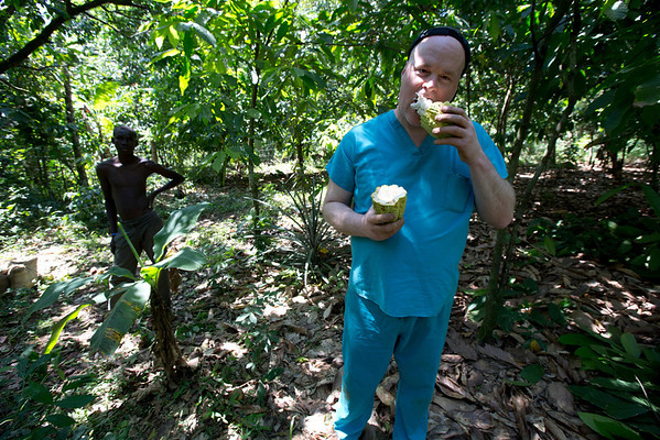 Tom Wall of Holy Name Medical Center tries a cocoa bean off the tree in Milot, Haiti. <br /> Photos from Hopital Sacré Coeur, the CRUDEM foundation, and Holy Name Medical Center's involvement in Milot, Haiti.  Photo by Jeff Rhode / Holy Name Medical Center 3/17/13