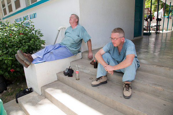 Mark Keane and Cyril Coffey relax for a moment at the Crudem Foundation. A team of Holy Name Medical Center employees traveled to  Milot, Haiti to run new electric and communications cable, and get a pair of generators installed and operational. The team employed and taught a crew of local Haitian workers on the projects.<br /> Photos from Hopital Sacré Coeur, the CRUDEM foundation, and Holy Name Medical Center's involvement in Milot, Haiti.  Photo by Jeff Rhode / Holy Name Medical Center 9/7/12