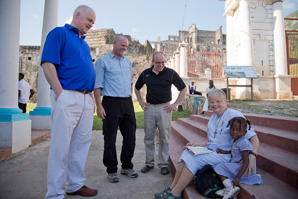 Tom Wall, Pete De Graaf, and Dr. Adam Jarrett, all of Holy Name Medical Center, talk with Sr. Anne Crawley  following a mass at Our Lady of the Immaculate Conception Church in Milot, Haiti. In the background is the Sans Souci Palace.<br /> Photos from Hopital Sacré Coeur, the CRUDEM foundation, and Holy Name Medical Center's involvement in Milot, Haiti.  Photo by Jeff Rhode / Holy Name Medical Center 3/17/13