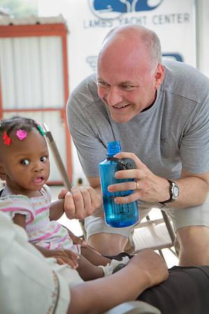 Mike Maron, President and CEO of holy Name Medical Center talks to a child at  Hopital Sacré Coeur in Milot, Haiti. <br /> Photos from Hopital Sacré Coeur, the CRUDEM foundation, and Holy Name Medical Center's involvement in Milot, Haiti.  Photo by Jeff Rhode / Holy Name Medical Center 6/13/12
