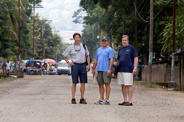 John Grangeia, Ted Carnevale, and Joe Lemaire outside the Crudem campus in Milot, Haiti.<br /> Photos from Hopital Sacré Coeur, the CRUDEM foundation, and Holy Name Medical Center's involvement in Milot, Haiti.  Photo by Jeff Rhode / Holy Name Medical Center 10/31/12