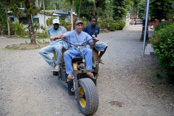 Steve Mosser rides a tricycle at the Crudem campus. A team of Holy Name Medical Center employees traveled to  Milot, Haiti to run new electric and communications cable, and get a pair of generators installed and operational. The team employed and taught a crew of local Haitian workers on the projects.<br /> Photos from Hopital Sacré Coeur, the CRUDEM foundation, and Holy Name Medical Center's involvement in Milot, Haiti.  Photo by Jeff Rhode / Holy Name Medical Center 9/7/12