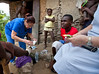 Dr. Judith Kutzleb sees a patient in the mountains of Milot, Haiti. The patient left Hopital Sacre Coeur with an infected foot because she needed to care for her 12 children and would need amputation in the future if the infection was not cared for properly. <br /> <br /> Photos fromPhotos from Hopital Sacré Coeur, the CRUDEM foundation, and Holy Name Medical Center's involvement in Milot, Haiti.  Photo by Jeff Rhode / Holy Name Medical Center 10/24/13