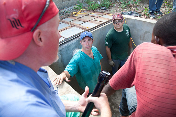 A team of Holy Name Medical Center employees traveled to  Milot, Haiti to run new electric and communications cable, and get a pair of generators installed and operational. The team employed and taught a crew of local Haitian workers on the projects. Jimmy Candela is in the center.<br /> Photos from Hopital Sacré Coeur, the CRUDEM foundation, and Holy Name Medical Center's involvement in Milot, Haiti.  Photo by Jeff Rhode / Holy Name Medical Center 9/4/12