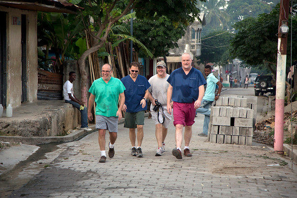 Dr. Adam Jarrett, Dr. Chris Englert, Dr. Steve Wells, and Tom Wall,on the street in Milot, Haiti. <br /> Photos from Hopital Sacré Coeur, the CRUDEM foundation, and Holy Name Medical Center's involvement in Milot, Haiti.  Photo by Jeff Rhode / Holy Name Medical Center 10/25/13
