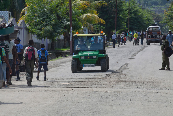 Marty Wagner and Jimmy Candela drive the gator on the street in Milot, Haiti.<br /> Photos from Hopital Sacré Coeur, the CRUDEM foundation, and Holy Name Medical Center's involvement in Milot, Haiti.  Photo by Jeff Rhode / Holy Name Medical Center 10/23/13
