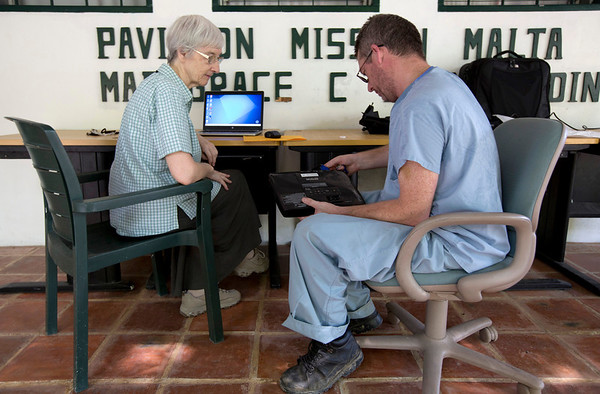 Sr. Maureen Boggins meets with Cyril Coffey from Holy Name Medical Center to introduce her to new technology she will use to teach english to her Haitian student. <br /> Photos from Hopital Sacré Coeur, the CRUDEM foundation, and Holy Name Medical Center's involvement in Milot, Haiti.  Photo by Jeff Rhode / Holy Name Medical Center 10/22/13