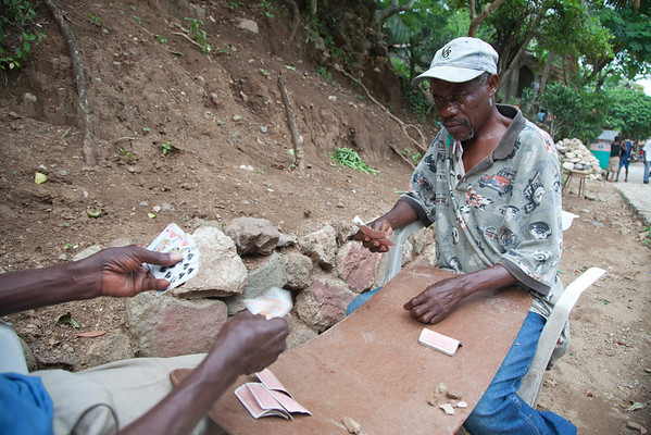 Men playing cards on the street in Milot, Haiti. <br /> Photos from Hopital Sacré Coeur, the CRUDEM foundation, and Holy Name Medical Center's involvement in Milot, Haiti.  Photo by Jeff Rhode / Holy Name Medical Center 6/13/12