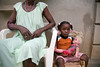 A little girl sits with her grandmother and doll outside her home in Milot, Haiti. <br /> Photos from Hopital Sacré Coeur, the CRUDEM foundation, and Holy Name Medical Center's involvement in Milot, Haiti.  Photo by Jeff Rhode / Holy Name Medical Center 10/31/12