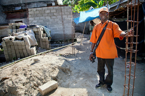 A man stands on the site he wants to build his new house for he and his 4 children. Blocks must be made with a mold a few at a time, until there are enough to make a level on the house. Photos from Hopital Sacré Coeur, the CRUDEM foundation, and Holy Name Medical Center's involvement in Milot, Haiti.  Photo by Jeff Rhode / Holy Name Medical Center 10/21/13