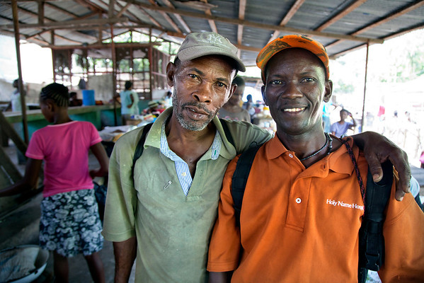 2 men in the market in Milot, Haiti. Photos from Hopital Sacré Coeur, the CRUDEM foundation, and Holy Name Medical Center's involvement in Milot, Haiti.  Photo by Jeff Rhode / Holy Name Medical Center 10/25/13