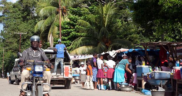 Vendors outside Hopital Sacre Coer in Milot, Haiti. Photos from Hopital Sacré Coeur, the CRUDEM foundation, and Holy Name Medical Center's involvement in Milot, Haiti.  Photo by Jeff Rhode / Holy Name Medical Center 10/21/13
