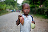 A child holds up cocoa beans in Milot, Haiti. <br /> Photos from Hopital Sacré Coeur, the CRUDEM foundation, and Holy Name Medical Center's involvement in Milot, Haiti.  Photo by Jeff Rhode / Holy Name Medical Center 6/14/12