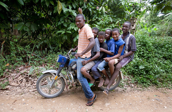 6 people crowd onto a small motorcycle in Milot, Haiti. Photos from Hopital Sacré Coeur, the CRUDEM foundation, and Holy Name Medical Center's involvement in Milot, Haiti.  Photo by Jeff Rhode / Holy Name Medical Center 10/22/13