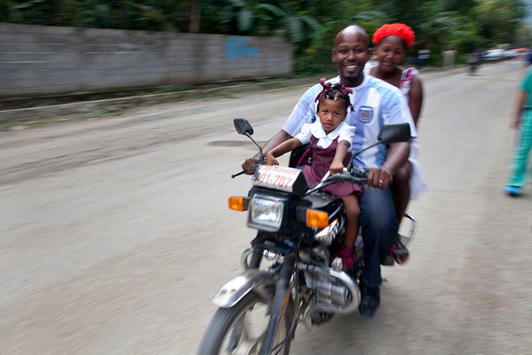 A family on their motorcycle in Milot, Haiti.  Photos from Hopital Sacré Coeur, the CRUDEM foundation, and Holy Name Medical Center's involvement in Milot, Haiti.  Photo by Jeff Rhode / Holy Name Medical Center 10/29/12