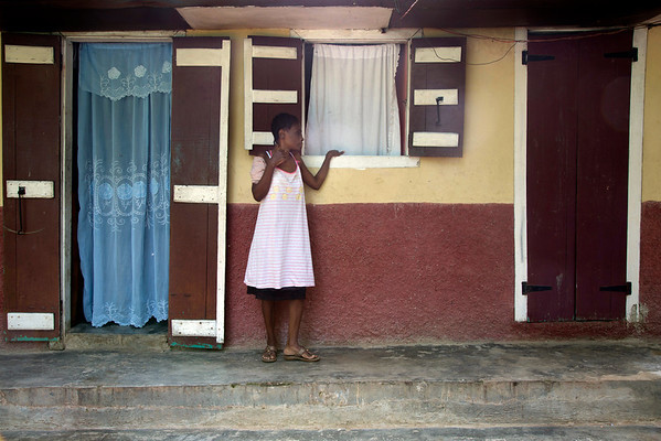A woman outside her home in Milot, Haiti. <br /> Photos from Hopital Sacré Coeur, the CRUDEM foundation, and Holy Name Medical Center's involvement in Milot, Haiti.  Photo by Jeff Rhode / Holy Name Medical Center 10/24/13