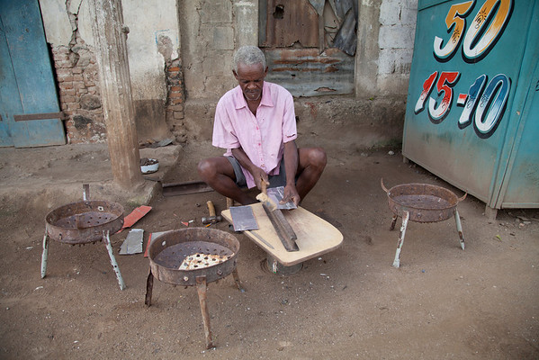 A man makes charcoal grills to sell on the street in Milot, Haiti. <br /> Photos from Hopital Sacré Coeur, the CRUDEM foundation, and Holy Name Medical Center's involvement in Milot, Haiti.  Photo by Jeff Rhode / Holy Name Medical Center 11/1/12