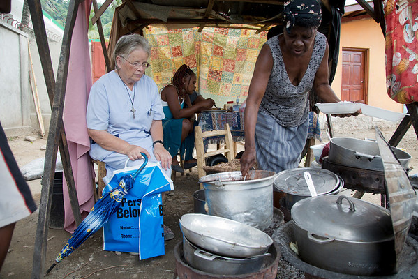 Sr. Anne Crawley buys food from a street vendor in Milot, Haiti.<br /> Photos from Hopital Sacré Coeur, the CRUDEM foundation, and Holy Name Medical Center's involvement in Milot, Haiti.  Photo by Jeff Rhode / Holy Name Medical Center 11/1/12