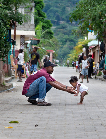 A man teaching his daughter to take her first steps in Milot, Haiti. <br /> Photos from Hopital Sacré Coeur, the CRUDEM foundation, and Holy Name Medical Center's involvement in Milot, Haiti.  Photo by Jeff Rhode / Holy Name Medical Center 11/1/12
