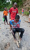 Children with a hand made toy wheel barrow on the street in Milot, Haiti. Photos from Hopital Sacré Coeur, the CRUDEM foundation, and Holy Name Medical Center's involvement in Milot, Haiti.  Photo by Jeff Rhode / Holy Name Medical Center 6/13/12