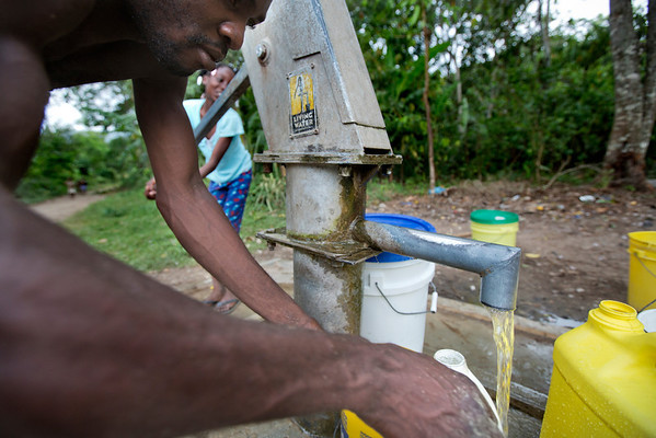 A man gets water at a well pump in Milot, Haiti. <br /> Photos from Hopital Sacré Coeur, the CRUDEM foundation, and Holy Name Medical Center's involvement in Milot, Haiti.  Photo by Jeff Rhode / Holy Name Medical Center 6/14/12