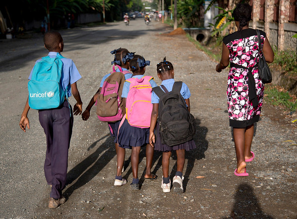 Children walking to school on the street in Milot, Haiti. <br /> Photos from Hopital Sacré Coeur, the CRUDEM foundation, and Holy Name Medical Center's involvement in Milot, Haiti.  Photo by Jeff Rhode / Holy Name Medical Center 6/13/12