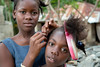 Children do each others hair on the street in Milot, Haiti. <br /> Photos from Hopital Sacré Coeur, the CRUDEM foundation, and Holy Name Medical Center's involvement in Milot, Haiti.  Photo by Jeff Rhode / Holy Name Medical Center 10/29/12