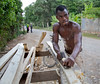 A man works building caskets on the street in Milot, Haiti. <br /> Photos from Hopital Sacré Coeur, the CRUDEM foundation, and Holy Name Medical Center's involvement in Milot, Haiti.  Photo by Jeff Rhode / Holy Name Medical Center 6/14/12