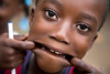 A child makes a face for the camera, in Milot, Haiti. <br /> Photos from Hopital Sacré Coeur, the CRUDEM foundation, and Holy Name Medical Center's involvement in Milot, Haiti.  Photo by Jeff Rhode / Holy Name Medical Center 10/31/12