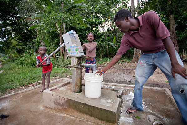 A man gets water from a pump well in Milot, Haiti. <br /> Photos from Hopital Sacré Coeur, the CRUDEM foundation, and Holy Name Medical Center's involvement in Milot, Haiti.  Photo by Jeff Rhode / Holy Name Medical Center 10/22/13