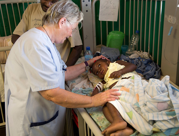 Sr. Anne Crawley with a child at Hopital Sacre Coeur.<br /> Photos from Hopital Sacré Coeur, the CRUDEM foundation, and Holy Name Medical Center's involvement in Milot, Haiti.  Photo by Jeff Rhode / Holy Name Medical Center 3/13/13