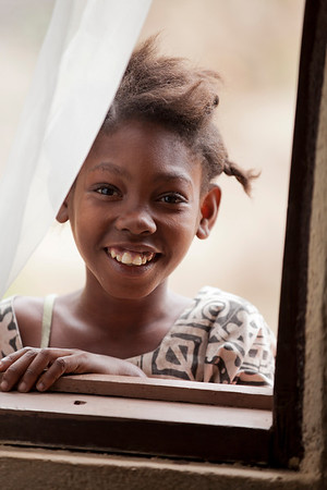 A girl smiles for a photo in Milot, Haiti. <br /> Photos from Hopital Sacré Coeur, the CRUDEM foundation, and Holy Name Medical Center's involvement in Milot, Haiti.  Photo by Jeff Rhode / Holy Name Medical Center 3/14/13