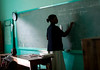 A school teacher in a classroom in Milot, Haiti. <br /> Photos from Hopital Sacré Coeur, the CRUDEM foundation, and Holy Name Medical Center's involvement in Milot, Haiti.  Photo by Jeff Rhode / Holy Name Medical Center 10/24/13