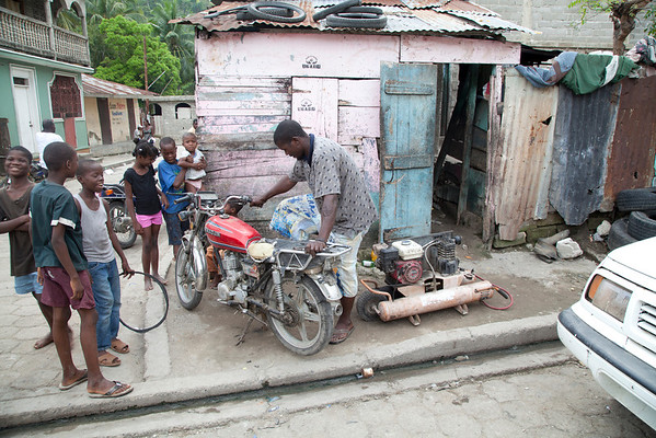 A motorcycle repair shop in Milot, Haiti.<br /> Photos from Hopital Sacré Coeur, the CRUDEM foundation, and Holy Name Medical Center's involvement in Milot, Haiti.  Photo by Jeff Rhode / Holy Name Medical Center 11/1/12
