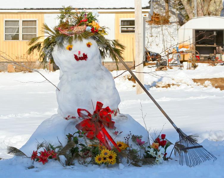 cheerfully decorated snow lady with rake 'broom' winter scene Phippsburg Maine, cute!