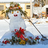 cheerfully decorated snow lady with rake 'broom' winter scene Phippsburg Maine, cute!