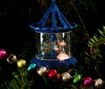 whirling carosell ornament on Christmas tree with antique, glass beads. The glass beads were my grandmother's.