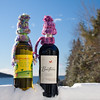 These bottle cozies are knit. They are a wonderful way to use left over bits of yarn and make an adorable hostess gift.