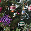 antique, glass Christmas ornaments hung in a holiday tree