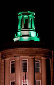 The Davenport Building, the Bath, Maine city hall on Front Street with green lights to celebrate Saint Patrick's Day