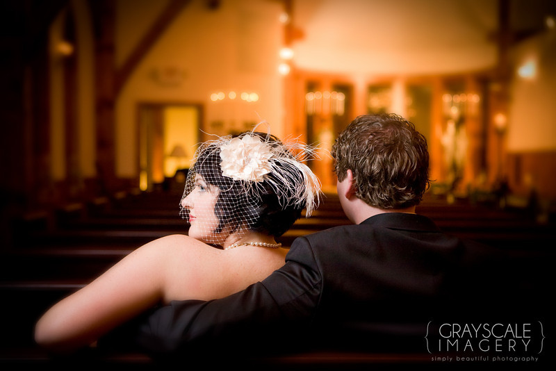 bride and groom have portrait in church after ceremony