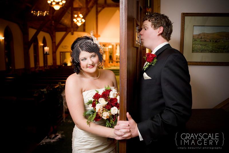 groom peeks at bride through door