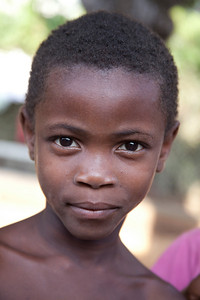 They didn't break her spirit when they cut off all her hair.  Orphan in Bohoc, Haiti.